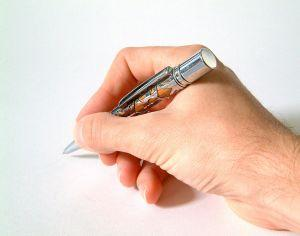 Photo of hand with pen on paper, symbolizing who can sign contracts for a corporation